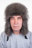 foto of raccoon  - A man in a hat of raccoon - JPG