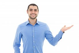 stock photo of arab man  - handsome arabic business man in blue shirt pointing at something isolated on white background - JPG