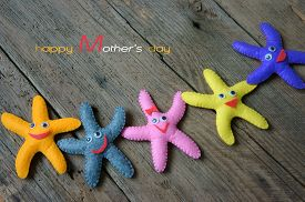 picture of starfish  - Happy mothers day with i love you mom message idea from colorful fabric starfish on wooden background abstract wooden texture mother - JPG