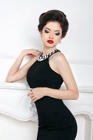 image of slim model  - Fashion beautiful brunette girl model in black dress posing against the wall - JPG
