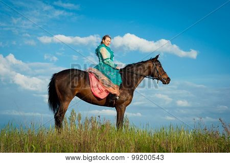 Horsewoman And Blue Sky