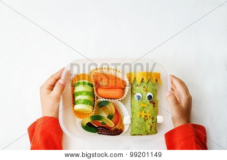 Childrens Hands Holding Lunch Box  For Halloween