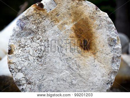 Rust on damaged concrete pillar.