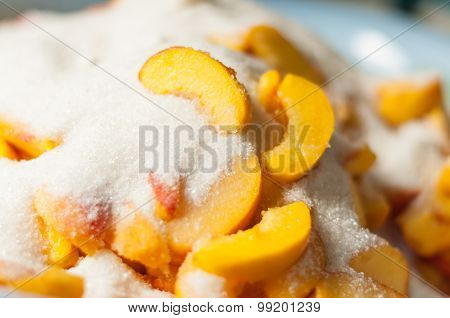 Ripe apricot slices with sugar. Cooking jam. Selective focus and unique perspective