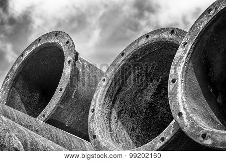 Many industrial old rusty steel pipes on the sky.