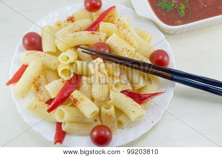 Pasta With Cherry Tomatoes And Red Pepper Served With A Tomato Sauce In A White Bow Ready For Eating