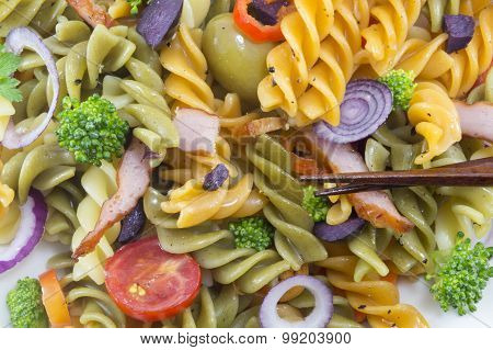 Pasta Meal Cooked With Vegetables With Fresh Vegetables Served With Chopsticks Close Up