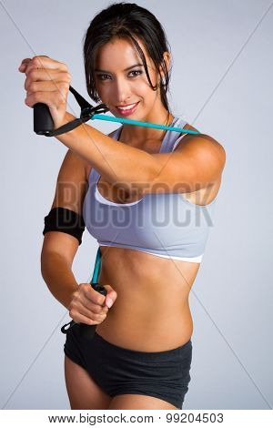 Beautiful latin fitness woman exercising