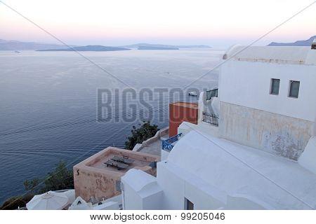 White Buildings Of Oia Village And Aegean Sea At Sunset, Santorini Island, Greece