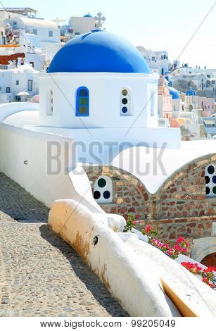 Oia Church With Blue Cupola On Santorini Island, Cyclades, Greece.