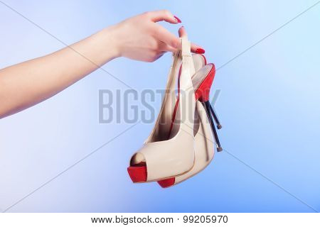 Female Shoes High Heels In Woman Hand. Shopping.