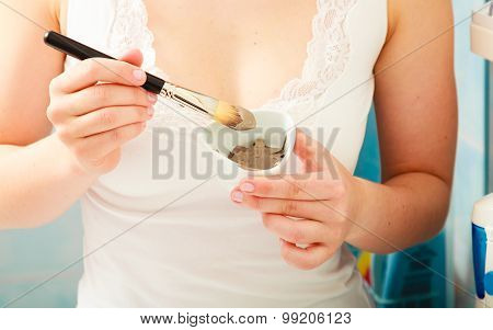 Brush And Clay Mask In Woman Hand