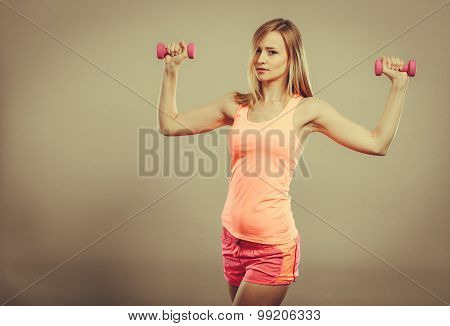 Fitness Woman Exercising With Dumbbells.