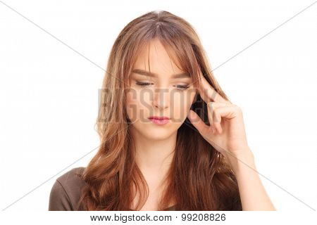 Studio shot of a pensive young woman trying to remember something isolated on white background