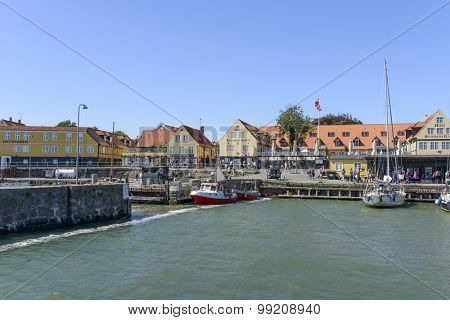 SVANEKE - AUGUST 14: Tourists enjoy the sunny weather and walking along the quay at the port on 14 August 2015 in Svaneke on Bornholm Island, Denmark.