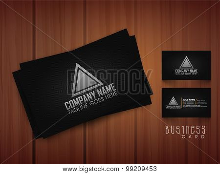 Stylish business card set in black color on wooden background.