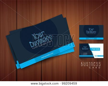 Creative professional business or visiting card design on shiny wooden background.