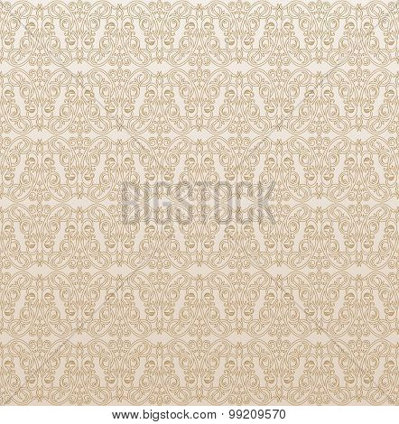 Seamless background in Arabic style. Gold patterns in beige wallpaper for textile design. Traditional oriental decor