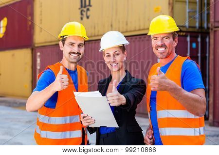 Two workers and manager of shipment company discussing freight or shipment documents