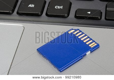 Sd Media Card On A Laptop Computer Close Up