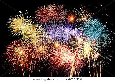 Grand finale with fireworks of different colors against a dark background