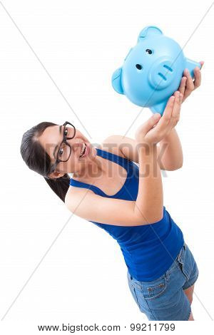 Happy woman holding pink piggy bank isolated on white background