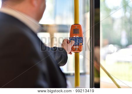 ST. PETERSBURG, RUSSIA - AUGUST 17, 2015: Deputy General Director of Information Networks LTD Kirill Petrenko demonstrate the PayPass technology in transport ticketing system in the line 5 trolleybus