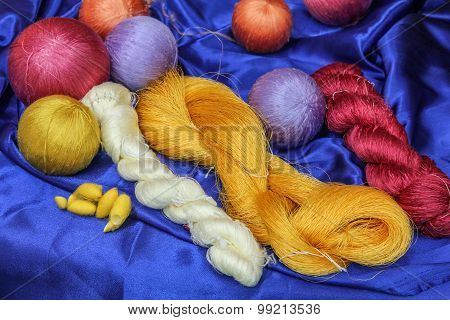 Colorful raw silk thread and silk cocoons.