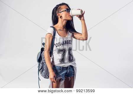 Stylish girl drinking take away coffee disposable cup urban casual style concept lifestyle fashion