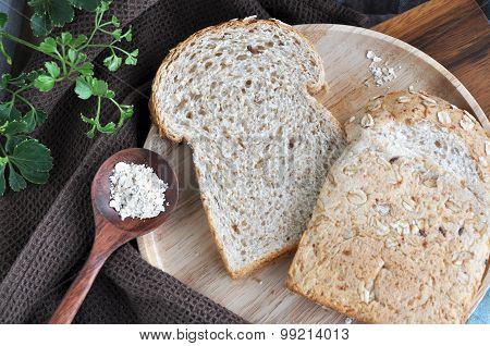 Wheat Bread On Wooden Plate