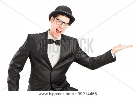 Young performer in black suit dancing isolated on white background