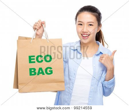 Woman with shopping bag and thumb up for showing eco bag
