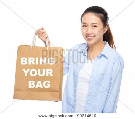 Young woman with shopping bag ans showing bring your bag
