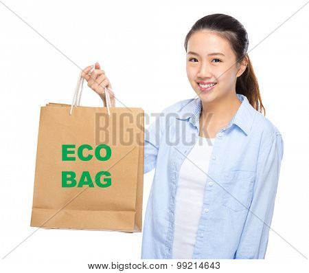 Young woman with shopping bag ans showing eco bag