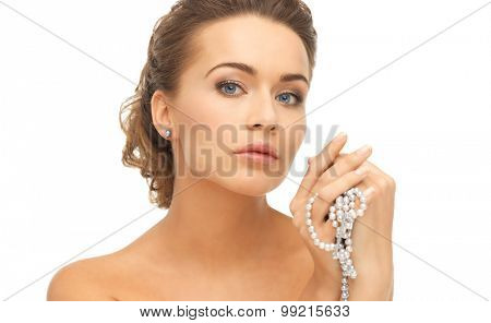 beautiful woman wearing pearl earrings and necklace