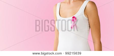 healthcare, people and medicine concept - close up of woman in white shirt with pink cancer awareness ribbon