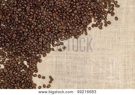 Roasted Coffee Bean On Burlap Sack Background