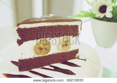 Piece Of Chocolate With Banana Cake In Vintage Style