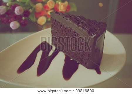 Piece Of Dark Chocolate Cake In Vintage Style