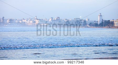 Essaouira , Morocco.  City and Wilaya  in  mist  at sunset. View from the beach