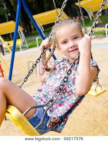 Adorable Smiling Little Girl Having Fun On A Swing