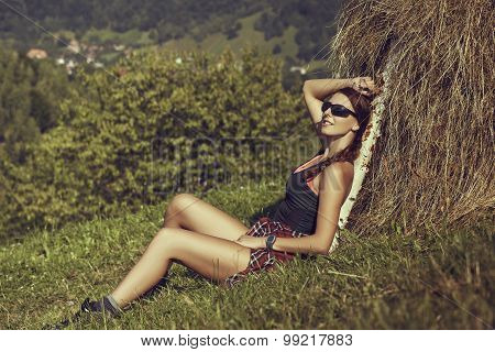 Woman Traveler Resting Near A Haystack