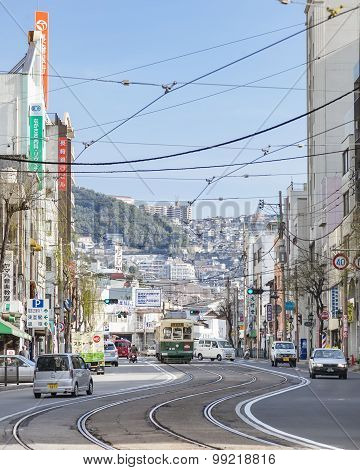 Nagasaki, Japan - February 23, 2012: Nagasaki City With Tram Railway Transportation And Cityscape Ba