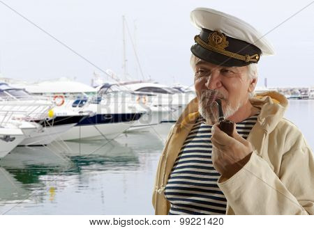Captain. Sailor man in marina port with boats background