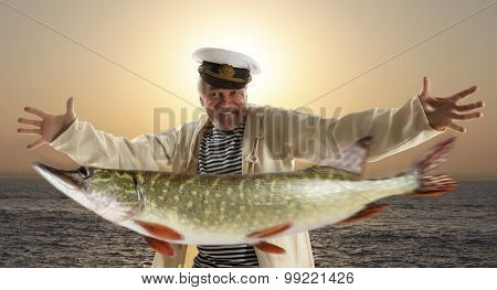 Joyful fisherman with big fish