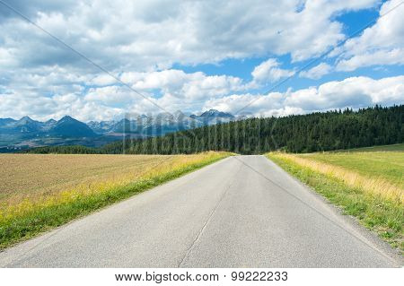 A View Of The Tatra Mountains And Highway In Summer