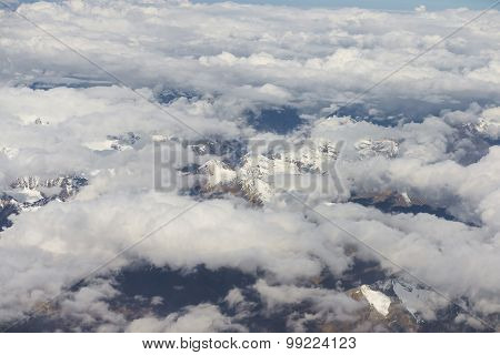 View of the Himalayas mountain range from the airplane window.