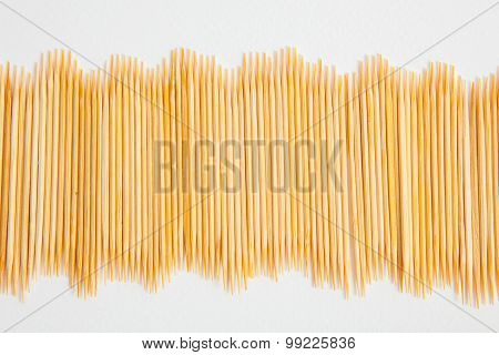 Bunch Of Toothpicks On White Paper Background