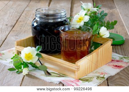 Home Health Rosehip Syrup On A Wooden Table
