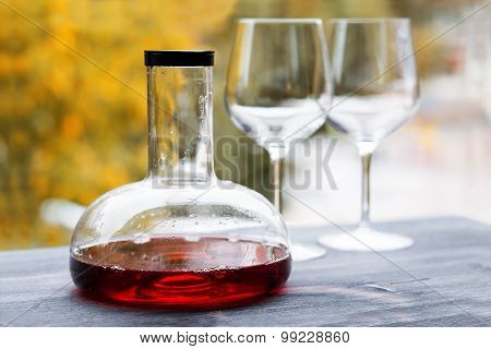 wine decanter and empty glasses